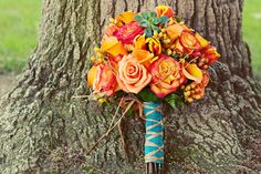 Beautiful mix of oranges, pinks and yellow with a hint of teal. Its always difficult picking flowers to go with teal dresses. I think this is a fabulous idea