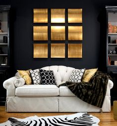 Artwork for wall, black with natural floors, white upholstered headboard, animal coverlet