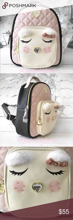"""NewBJ Quilted Winged Heart Backpack Totally obsessed with this medium size backpack. Black sides, bottom & back. Blush pink front with ivory angel face zip pocket. Inside zip pocket.  Front zip pocket, 7.5"""" x 7.5"""" includes depth. NWT Price is firm! NWT Betsey Johnson Bags"""