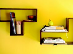 Yellow wall and book shelf for the bathroom.