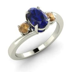 http://rubies.work/0745-blue-sapphire-earrings/ Oval-Cut Sapphire Ring in Platinum with Brown Diamond