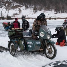 Armadillo Merino® Champions James Hubbard and Marc Palmer on the Ice Run, a 400 mile ride across the frozen Lake Baikal in Siberia on 30 yr old Ural Motorbikes! The boys trusted Armadillo Merino® for their baselayer, and it looks like they needed it.