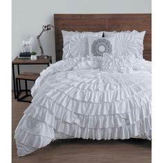 Get an expensive designer look for less. This elegant comforter set easily adds style and class to your bedroom. Featuring beautiful circular ruffles, this charming comforter has a solid reverse pattern for a clean look.