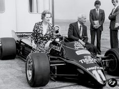 Margaret Thatcher and Colin Chapman sitting on the Lotus 91 in 1982.