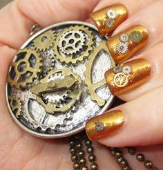 Not crazy about the gold but really liking the gears on it... Steampunk Nails