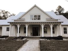 architecture #construction #farmhouse #metalroof #boardandbatten #florida @urbangraceinteriors