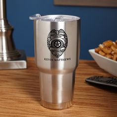 Whether they're a new or retiring law enforcement officer, long days are common for a cop. Give him a gift he needs with this personalized insulated travel mug.