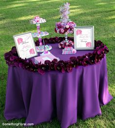 A purple bridal shower welcome table featuring a circle of purple orchids around the table edge and a custom-designed favor (earring) holder accented with roses and orchids. Design by Something Floral / Something Spectacular (Warren, MI). Bridal Shower Party, Bridal Shower Decorations, Bridal Shower Invitations, Whimsical Wedding, Purple Wedding, Wedding Flowers, Floral Wedding, Wedding Vendors, Wedding Blog