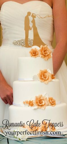 A romantic wedding cake topper of a bride and groom in gold.