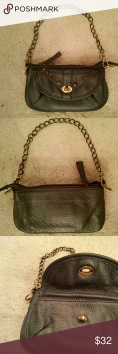 "Lulla Bella leather wristlet unbelievably soft leather in a beautiful pewter color; antique gold studs, hardware, and chain strap; strap can be removed; front has a pouch with flap and secured closure to hold your phone; zipper on top; inside are 2 sections - 1 open and the other has 3 card slots; great condition; Lulla Bella brand (look up the brand);  small size 7.5""x4"" Bags Clutches & Wristlets"