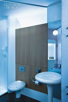 Marine Life: A Yacht-Inspired Auckland Apartment by Jasmax   The master bath's shower enclosure, like the guest bath's, is resin. Ross Lovegrove designed the sink, toilet, and fittings. #design #interiordesign #interiordesignmagazine #decor #bathroom