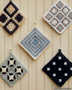 Granny Squares black and white...perfect for my kitchen... why didn't I think of that!!!! I keep making these and then taking it out... I could have made a dozen in the time it's taken me to do one. I just am not satisfied with the way mine look....The picture ones are really cute. My kitchen needs potholders.