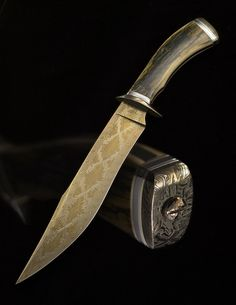 Fighter- Radiant Ribbon Damascus by Josh Smith. Maybe the most beautiful knife I've seen to date. Fantastic. Look at the Damascus.