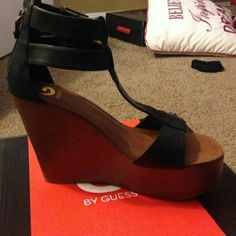 "*FINAL SALE* GUESS Wedges Guess wedges. Heel is about 5 1/2 in. Zipper in the back. ""T"" strap. Black and gold. Worn but a good condition; wearable. Back of heel coming up. Guess Shoes Wedges"