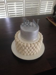 Raffeallo engagement cake with custom made topper. - created by Villa Chateau cakes