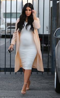 Stunning:Kim looked radiant as she stepping out in the same figure-hugging white dress on Monday in Los Angeles