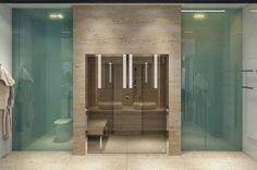 des cloisons en verre bleues et brun clair dans une salle de bain design