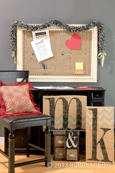 Natural burlap is an easy and inexpensive way to give your space an elegant, unexpected twist. From the burlap-covered bulletin board and the I-can't-believe-it's-burlap garland draped across it, to the DIY monograms and make-a-statement pillow, this room has just the right amount of rustic charm.