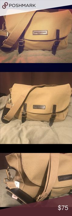 """🤗Brooks Brothers Messenger Bag, Gender Neutral! Made to last and perfect for travel! Canvas material, genuine leather trim. Very neutral, medium khaki shade, antique gold hardware. Structured base, it does not completely fall flat when not filled, just the right amount of stiffness. Appx 17"""" long, 9 1/2"""" tall, fully adjustable/removable strap. 25"""" longest strap drop and 14"""" is the shortest (when tightened all the way to the shoulder pad). Magnetic dual snap closure in front. Exterior pocket…"""