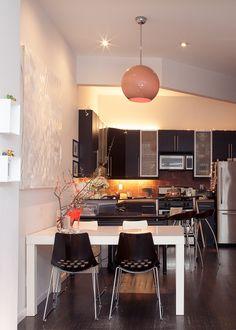 Black and white colour scheme, black cabinetry.