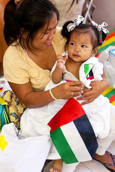 After receiving a surgery to repair her cleft lip, one-year-old Shaina snuggles close to her mother, Rowena. Shaina is one of several children who received life-transforming surgeries during Operation Smile's medical mission in Davao, Philippines. (Operation Smile Photo - Peter Stuckings)