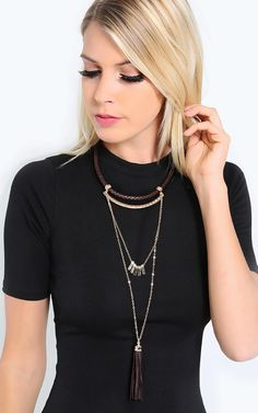 Add a boho flair in this braided layered tassel necklace. I MakeMeChic.com