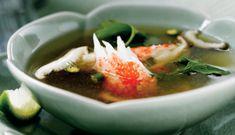 In a large (12-inch) nonstick pan or stockpot, cook seafood stock, water, fish sauce, lemongrass, galangal and garlic over medium-high heat