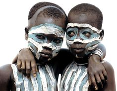 "Africa | ""Two Surma children painted as twins.  Using ground chalk and natural earth pigments, Surma children are taught body painting by their parents at an early age. this instills a sense of pride in their creativity, and keeps their ancient traditions alive."" Ethiopia. 