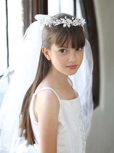 A very lovely faux pearl and crystal floral headpiece with two tier veil can be worn for her first holy communion or at your wedding. $34.95