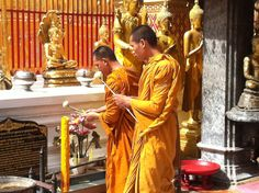 Doi Suthep Temple, Chiang Mai, Thailand. Monks in devotion.