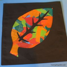 leafs cut from tissue paper, placed onto contact paper.  Leaf and veins glued into place