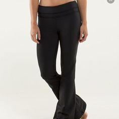 Black lulu lemon yoga pants with ruffle detail Worn a few times. Flare at the bottom; small black ruffle at the top lululemon athletica Pants Leggings