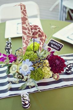Name your tables at the reception after animals.  Create cute origami animals for each centerpiece.