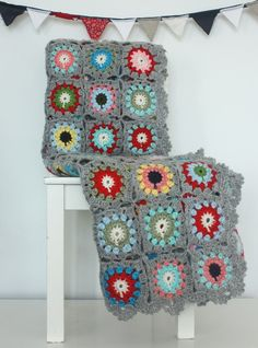 beautiful gray and bright crochet blanket