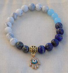 Throat Chakra mala Bracelet with Hamsa - Reiki energized - Lapis Lazuli, Howlite, Imperial Jasper, Labradorite http://etsy.me/2nZ3xk9 #malabracelet #moonandstarmala