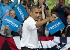 #13 9/17/12 President Barack Obama points to the crowd as he leaves a campaign event at Eden Park's Seasongood Pavilion, Monday, Sept. 17, 2012, in Cincinnati, Ohio.  Associated Press