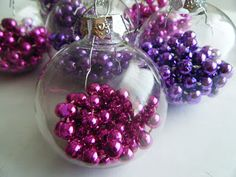 clear glass ornament filled with bead necklaces