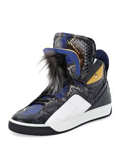 Fendi iconic Monster high-top sneaker with stud-detail down back. Python leather upper; calf leather embroidery. Reinforced round toe; lace-up front with double tongue. Dyed silver fox fur (Finland) a