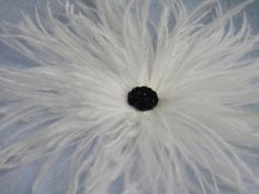 Ostrich Feather Plumes Wedding White Flower Black Center Hair Clip. $24.00, via Etsy.
