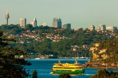 A ferry boat en route from Circular Quay in Sydney to Manly, (with Sydney's Central Business District in the background), Sydney, New South Wales, Australia by Blaine Harrington