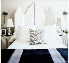 beautiful gothic arch-shaped screen as headboard.  Glamorous crystal lamps    Decorare