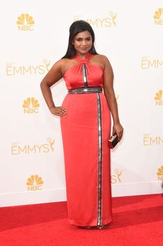 Pin for Later: See Every Dress to Hit the Emmy Awards Red Carpet Mindy Kaling Mindy Kaling kept our girl-crush going strong in a Kenzo column dress, Jimmy Choo shoes, a Swarovski ear cuff, and she carried a Fiona Kotur clutch.