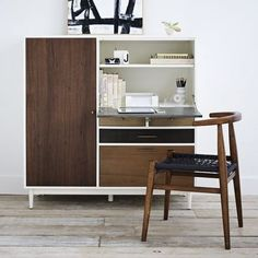 This side unit is a great investment piece for smaller spaces because it doubles as a desk and a storage piece.