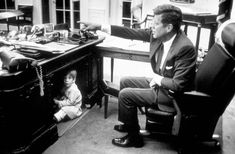 Family FunJohn Kennedy Jr. plays in the Oval Office at the White House, Washington, DC, on October 15, 1963.