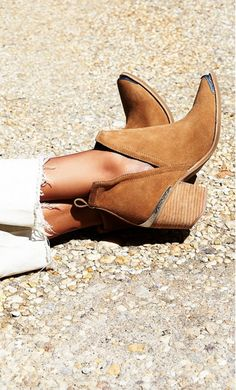 Love the little western detail on these camel suede ankle booties