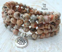 108 mala, Fire Lace Jasper, Mala Bracelet or Necklace,Reiki charged, Buddhist Rosary,Prayer beads, Gemstone, wrist mala, Lotus, buddha, ohm by LifeForceEnergyShop on Etsy https://www.etsy.com/listing/471557062/108-mala-fire-lace-jasper-mala-bracelet