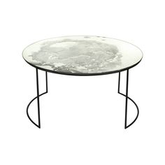 Add a touch of chic to your home with this Iridescent Glass Round Table from Amara. Its stylish rounded profile has been crafted by hand using a metal framing and glass table top. This surface has bee
