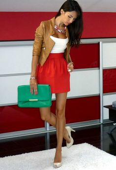 Huge clutch, bright skirt, leather jacket? Yessir
