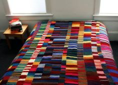 Blanket made of many garter stitch scarves. Have to try this when my sky blanket is done at the end of December.