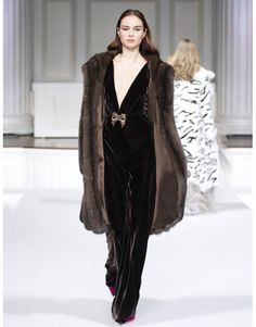 Every time I see some this lavish I look at the designer and guess who?  Oscar de le Renta